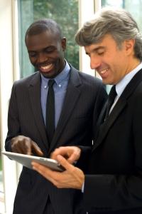 businessmen looking at iPad
